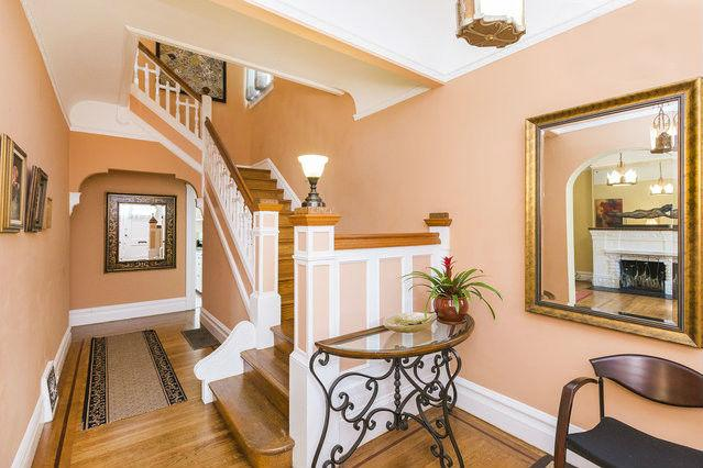 This first floor landing has platform staircase leading to the second floor with intricate woodwork! - 4 BR Haight Ashbury Victorian Home, Perfect Location! - San Francisco - rentals