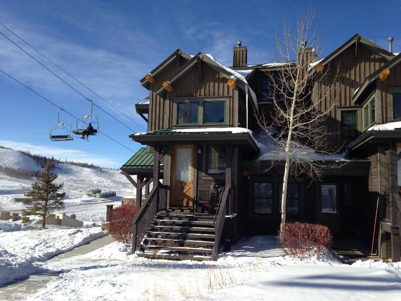 Condo entrance is just right of tree.  - Ski-in Ski-out 2 Bedroom 2 Bath Condo At Kicking Horse Lodges - Granby - rentals