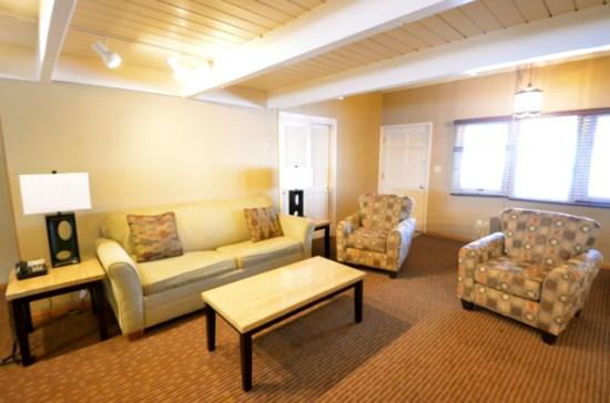 Spacious Living Room with Fireplace, Sofa Sleeper, Television, and lots of Natural Light. - 3 BR Ski In/Ski Out Mountain Villa - Recently Remodeled Condo - Just Behind Boyneland Lift - Boyne Falls - rentals