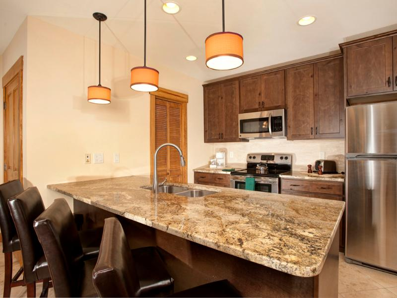Modern Kitchen with granite countertops and stainless steel appliances - The Springs in River Run Village 2BR/3BA + Murphy - Keystone - rentals