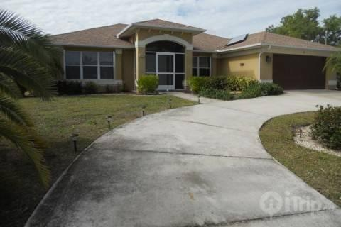 Front of house with circular driveway - Wonderful Cape Coral Home - Cape Coral - rentals
