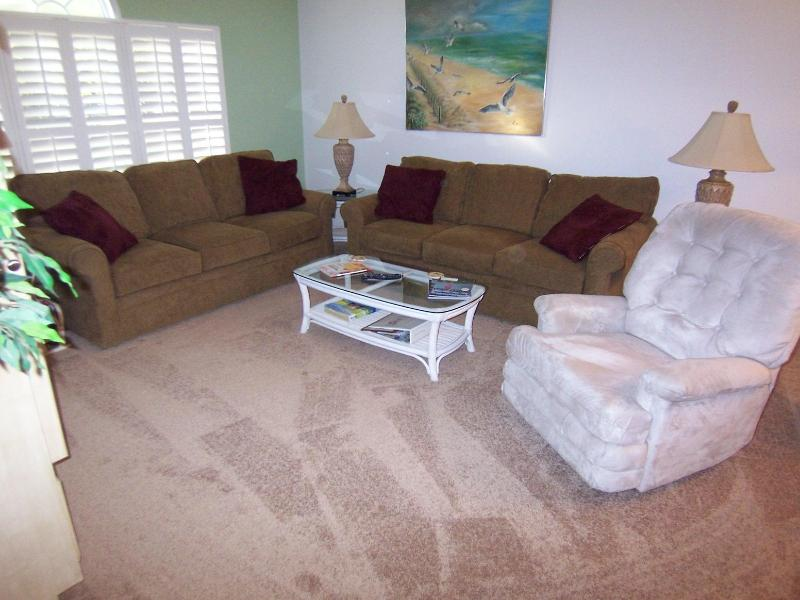 Spacious living room with two comfortable sofas and recliner - 1 BR BA (23DV), 2nd Floor, King, 1 Mile to Beach - Sunset Beach - rentals