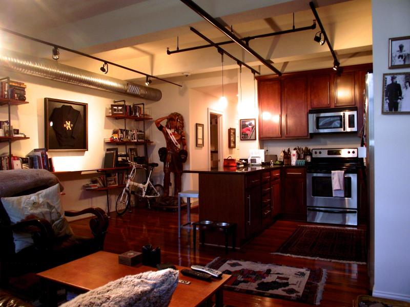 Well-equipped kitchen opens to living room - Upscale Loft-Style Downtown on Granby St - Norfolk - rentals