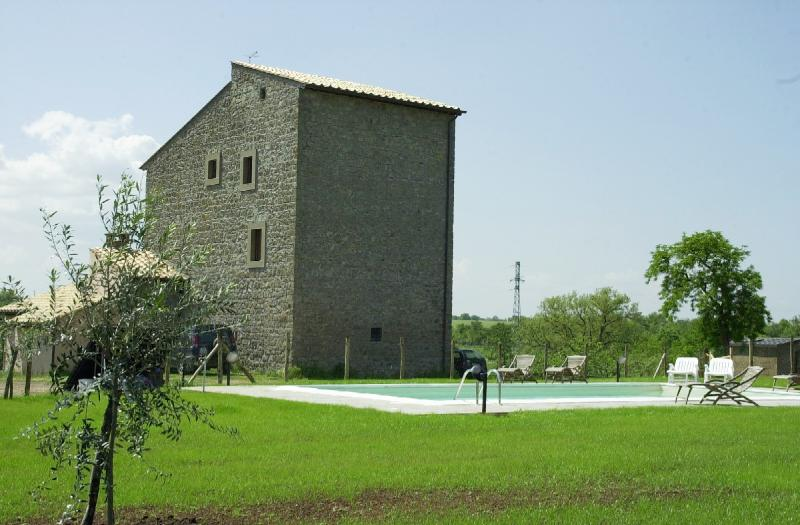 Welcome to SAN FRANCESCO! The house (1300's) and the pool. Outside furniture, umbrellas provided. - SAN FRANCESCO - From a Medieval Fortress to a Stunning Country Mansion - Viterbo - rentals