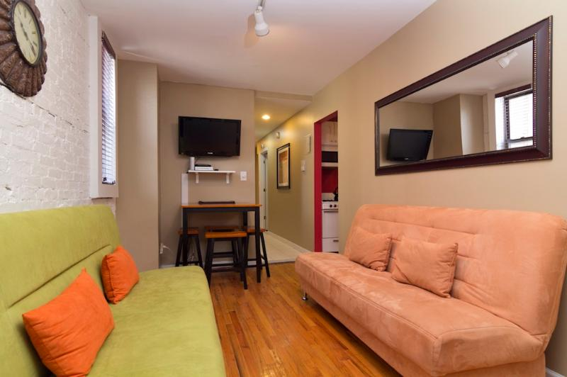 Living Room with Futon sofas - Sleeps 8! 3 Bed/2 Bath Apartment, Times Square, Awesome! (7783) - New York City - rentals