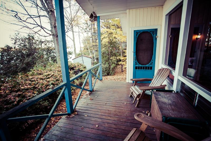 Covered porch overlooking Lower Buckhorn Lake. - Cottage Rental: Buckhorn, Ontario - Buckhorn - rentals