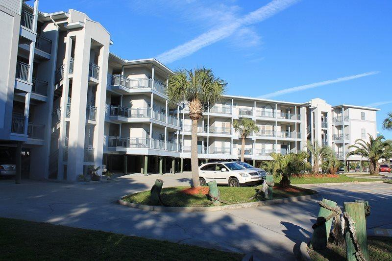 Enjoy spectacular views of the Savannah River entrance and Atlantic Ocean, ocean breezes, dolphin watching and beautiful sunrises and sunsets - Savannah Beach & Racquet Club Condos - Unit C306 - Tybee Island - rentals