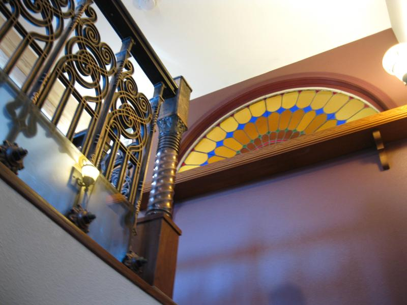 Entry view of Stained Glass and Rail - Downtown Historic Victorian Italianate Apartment - Denver - rentals