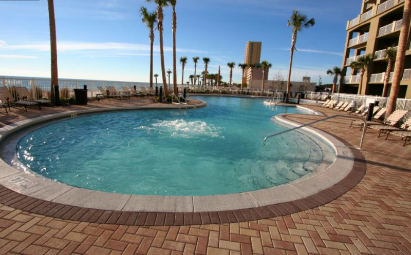View of beachfront pool.  Plenty of loungers to soak up the sun! - 2BR/2BA Great City & Beach Views - Panama City Beach - rentals