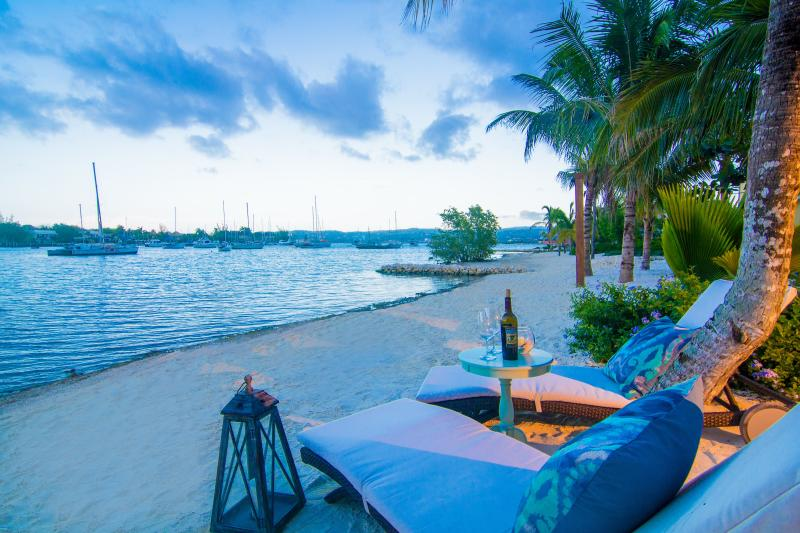 Take in the Caribbean sunset with a glass of wine right in front of your villa - Cozy Cove - 5 Bdrm Villa w/Pool, Gated Community - Montego Bay - rentals