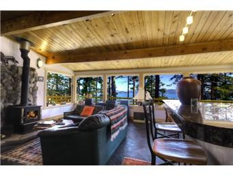 Living room with huge picture windows! View of spencer Spit and Lopez sound - Sun Rise Cliff House - Lopez Island - rentals