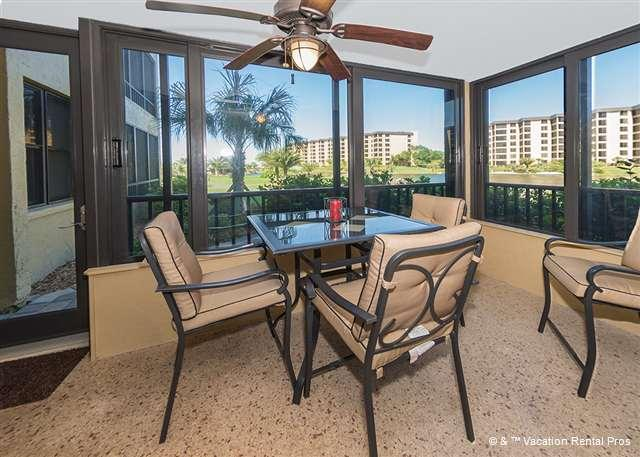 Plan your day over breakfast in the lanai - Gulf and Bay Club 102B Beach Front, Luxury Ground Floor unit - Siesta Key - rentals