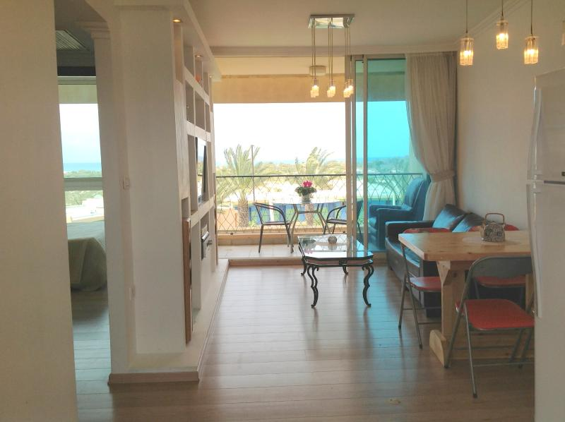 Living room, bolcony and master bedroom with sea vie - Israel Ceasaria - Fully Equipped 2br Sea View - Caesarea - rentals