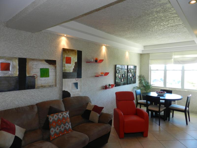 Espacious Living/Dining Room area - Charming Apartment in Miramar - San Juan - rentals