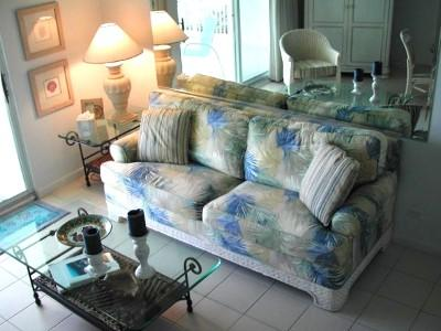 Living area with queen sleeper sofa - HEART OF SEVEN MILE BEACH DESIGNER OCEAN CONDO! - Grand Cayman - rentals