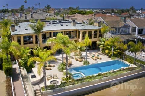 Stunning 9,500 sq. ft. 7 BR Peninsula Point Bay-front Estate with Pool, Spa, & Private Dock (3768096) - Image 1 - Newport Beach - rentals