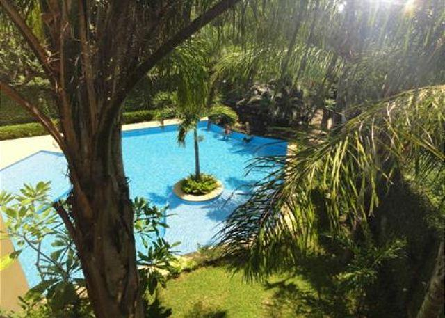 View of Pool and Gardens - Beautiful Two Bedroom Condo - Tamarindo - rentals