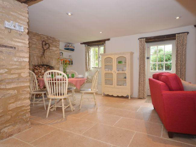 The lounge/dining area with exposed stonework - LITTL - Duntisbourne Abbots - rentals