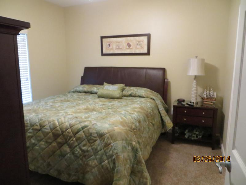 The master bedroom with king size bed, new bedding and carpet.   Sweet Dreams - Splash  One BedroomCondo with Daily Beach Service - Panama City Beach - rentals