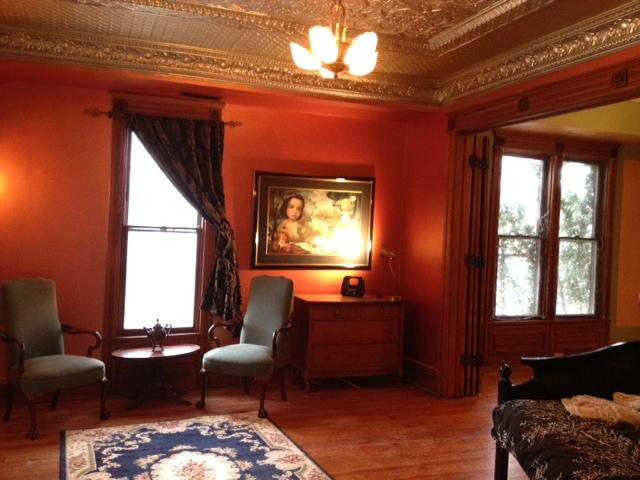 Living Room with tin ceiling and rare Mark Ryden lithograph - 1883 Downtown Manor - Eureka Springs - rentals