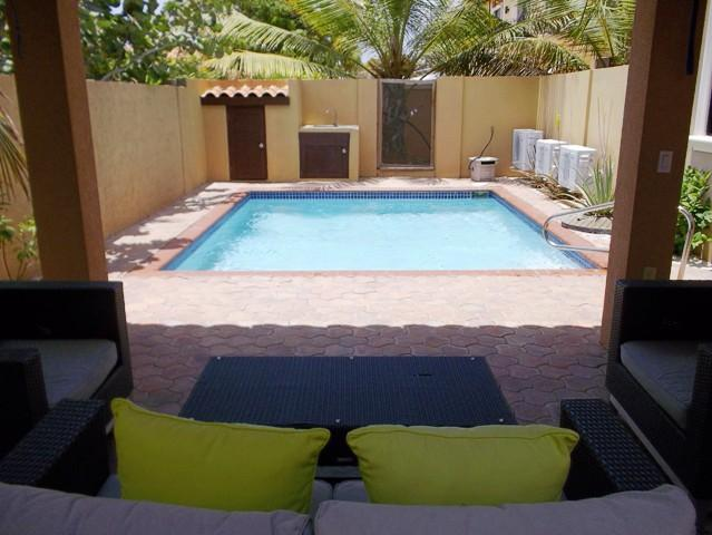 Enjoy you private terrace with swimming pool, outdoor furniture and shower! - Gold Coast Diamond Two-bedroom condo - GCD122A - Malmok Beach - rentals