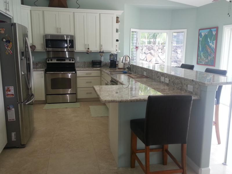 Huge Kitchen with full size appliances and access to pool and lanai - KAILUA DREAMS-MAKAI:  NEW, LUXURIOUS AND SPACIOUS LIVING - Kailua - rentals