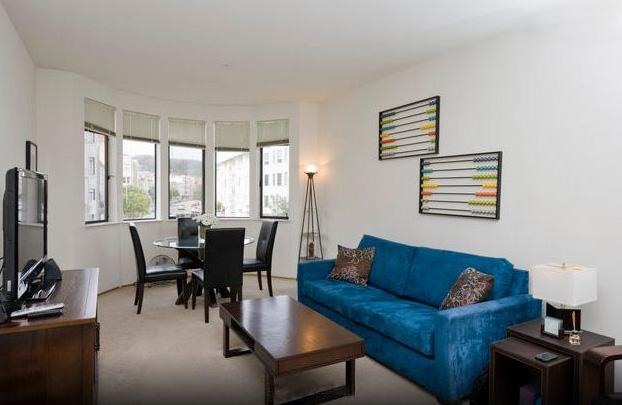 Enjoy eating at the table for four with views of the city before relaxing on the bright couch facing the flat-screen TV. - 1Br Near Fisherman's Wharf, Restaurants, Sights - San Francisco - rentals