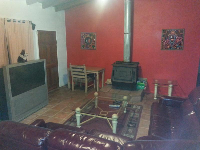 LIVING ROOM W/ WIDE SCREEN TV & WOOD BURNING STOVE - CATTS BY THE SEA - Ensenada - rentals
