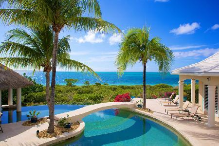 Beachfront Avalon with double edge infinity pool, swim up bar & lush greenery - Image 1 - Turtle Cove - rentals