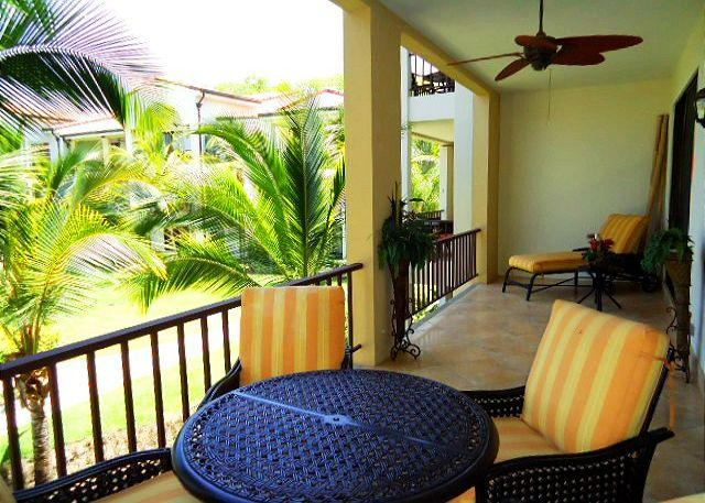 Enjoy the beautifully landscaped grounds and pool from the balcony. - Pacifico L1308 - Luxury One Bedroom Pacifico Condo - Custom Design - Playas del Coco - rentals