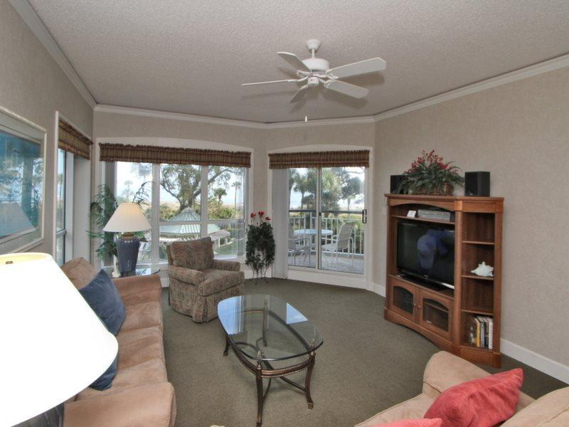 Living Room with Balcony Access at 3210 Windsor Court South - 3210 Windsor Court South - Hilton Head - rentals