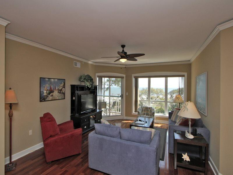 Living Room with Deck Access at 4505 Windsor Court North - 4505 Windsor Court North - Hilton Head - rentals