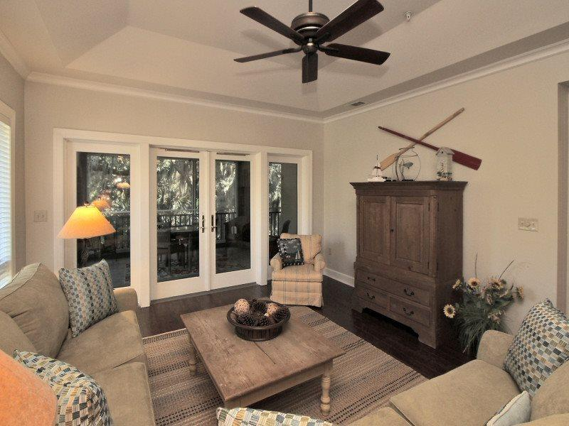 Living Room with Screen Porch Access at 8122 Wendover Dunes - 8122 Wendover Dunes - Hilton Head - rentals