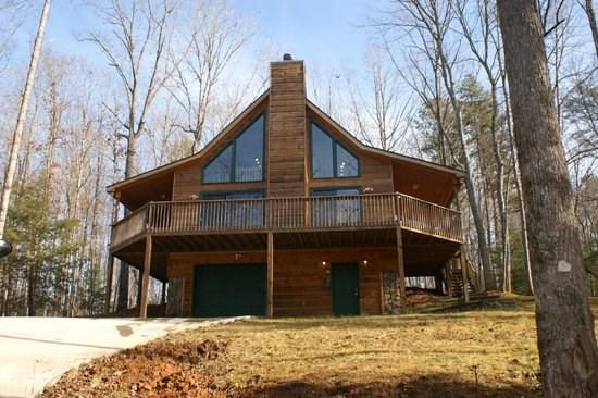 EAGLE MOUNTAIN CHALET*2BR/2BA CABIN IN THE COOSAWATTEE RIVER RESORT~LOCATED 1 MILE FROM R & R RIVER RETREAT~POOL TABLE~AIR HOCKEY~GAS GRILL~SAT TV~WOOD BURNING FIREPLACE~WIFI~HOT TUB~PLUS THE AMENITIES OF THE RESORT~$150/NIGHT! - Image 1 - Blue Ridge - rentals
