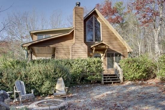 SERENITY*SECLUDED~2BR~2BA~CABIN WITH BREATHTAKING MOUNTAIN VIEWS~KING SIZED BED~SAT TV~HOT TUB~WIFI~PET FRIENDLY~GAS GRILL~WOOD BURNING FIREPLACE~FIRE PIT~WATER GARDEN~JETTED TUB IN MASTER BATH~ONLY $115/NIGHT! - Image 1 - Blue Ridge - rentals