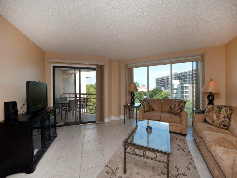 Living Room with Balcony Access and Flat Screen at 2518 Villamare - 2518 Villamare - Hilton Head - rentals