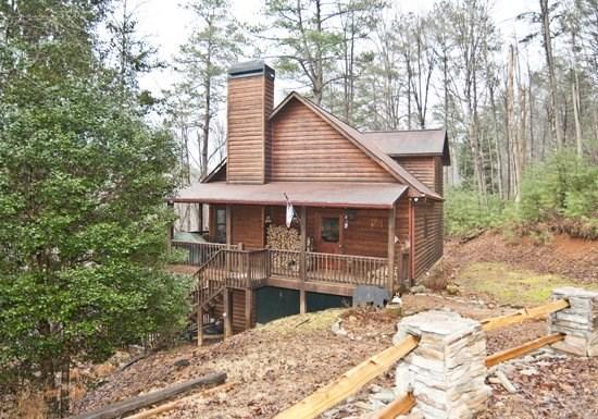 R&R; RIVER RETREAT*4BR~3BA~CABIN IN THE COOSAWATTEE RIVER RESORT~RIVER FRONTAGE~HOT TUB~GAS GRILL~AIR HOCKEY~FOOSBALL~SAUNA~WET BAR~WOOD BURNING FIREPLACE~SAT TV~PLUS ALL THE RESORT AMENITIES!~PETS WELCOME~SLEEPS 14!~$190/NIGHT!! - Image 1 - Blue Ridge - rentals