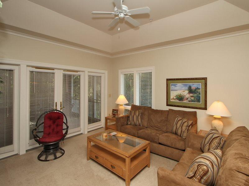 Living Room with Screen Porch Access at 8136 Wendover Dunes - 8136 Wendover Dunes - Hilton Head - rentals