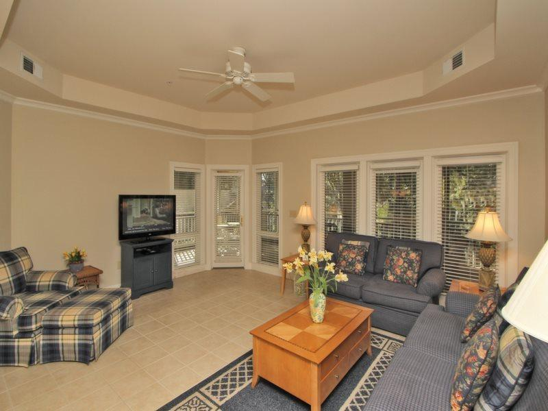 Living Room with Screen Porch Access at 8134 Wendover Dunes - 8134 Wendover Dunes - Hilton Head - rentals