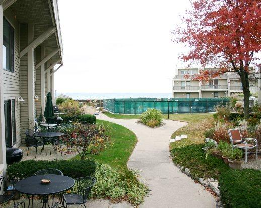 Patio and the Path to the Pool and Beach - Harbours 34 - Weekly stays begin on Saturdays - South Haven - rentals