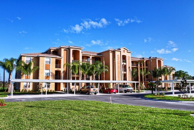 Front of Building  - (RS37) Beautiful Ground Floor River Strand Condo with Lanai and Golf Course Views. - Bradenton - rentals