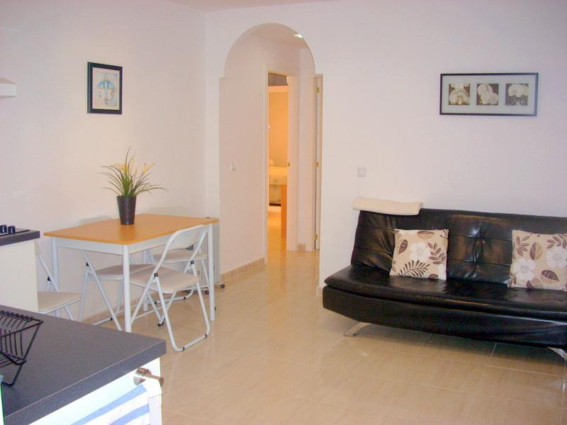 Sitting and dining area. - FANTASTIC 2 BEDROOM APARTMENT, LA CARIHUELA, MALAGA. - Malaga - rentals