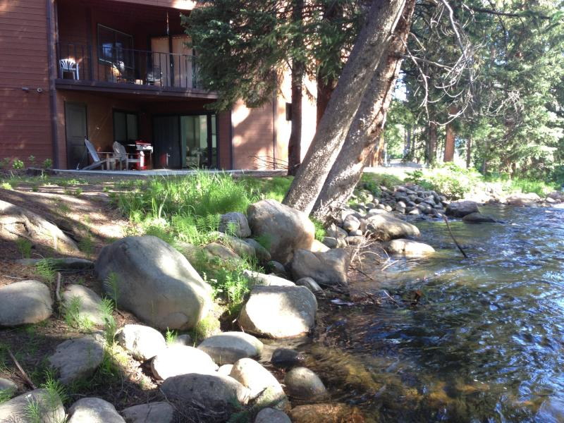 Relax in the addirondack chairs by the river - Riverfront - Ground Level Suite - Walk to village! - Winter Park - rentals