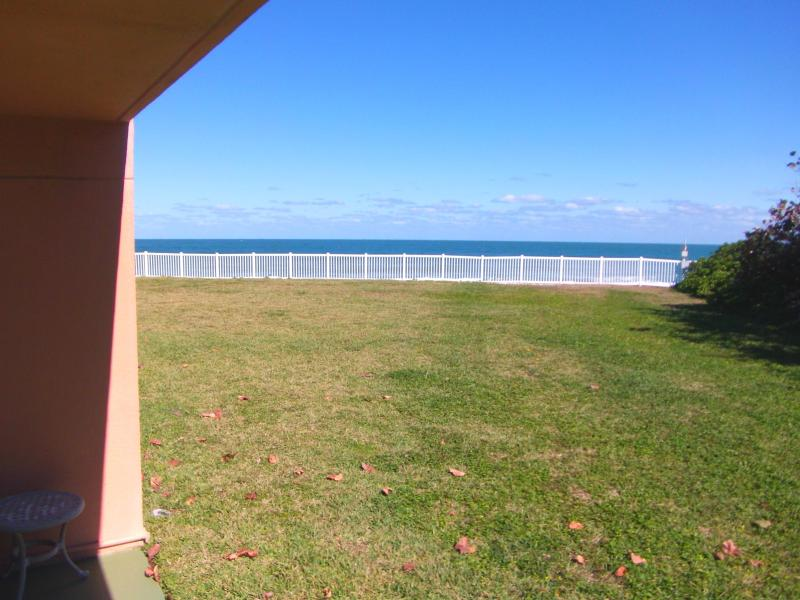 Large oceanfront grass area right off patio - Renovated - Luxury Condo - On the Beach - Satellite Beach - rentals