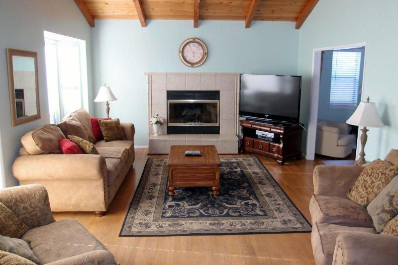 This large den has a fireplace, 47 inch TV and queen sofa bed. - Large, Well-Equipped Home; Just Steps to Beach! - Morro Bay - rentals