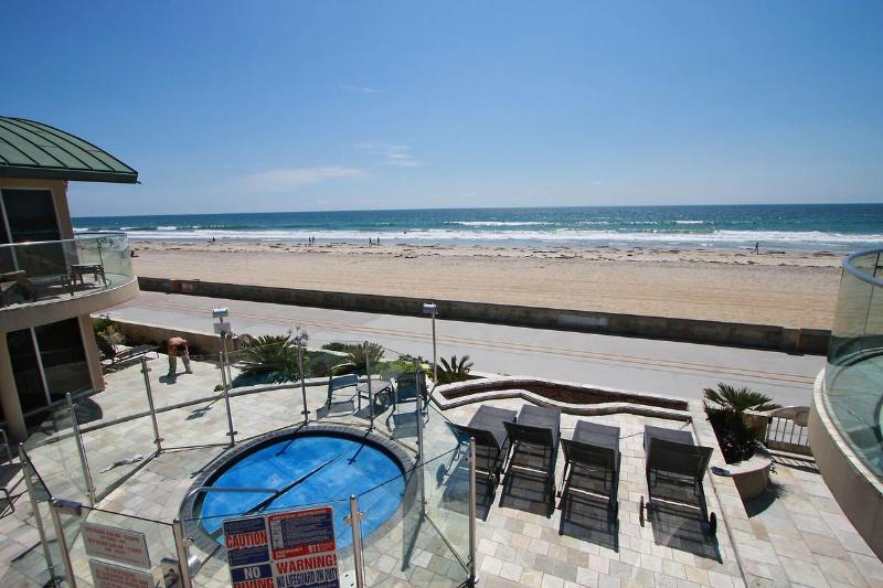 Patio and hot tub overlooking the boardwalk - Surf Rider Ocean Front Condo with Hot Tub - San Diego - rentals