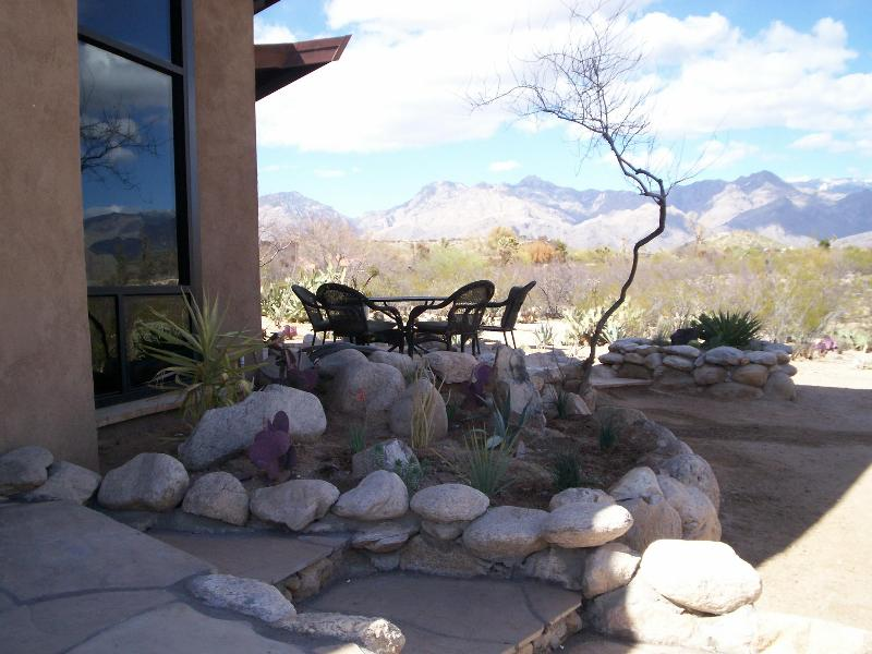 One of the outdoor sitting areas, this one, equipped with grill and outdoor dining furniture. - Desert Cloud at Sabino in Tucson - Tucson - rentals