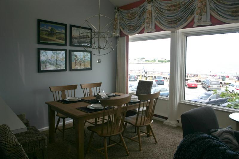Dining Area with views to beach - Oceanside Condo #1 - Hampton - rentals