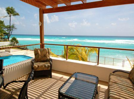 Extended patio overlooking beach and pool. - 2 Bedroom Beachfront Condo- High Demand Location - Saint Lawrence Gap - rentals