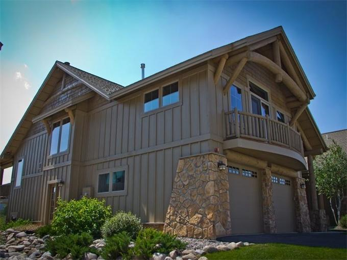 View of grand house; large balcony, view of creek and mountains on other side  - 30%+ off! Stunning Mtn/Water Views; Sauna - Big Sky - rentals